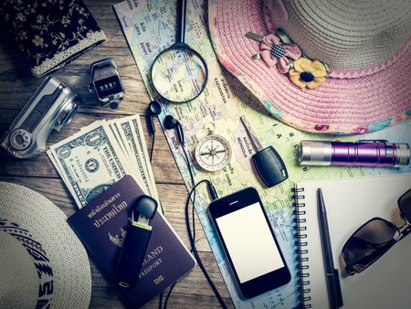 numerator: Set of travel accessory with mobile phone on wooden vintage background Stock Photo
