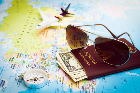 Travel concept. Sunglasses, Passport, Money, Compass and aircraft on the world map