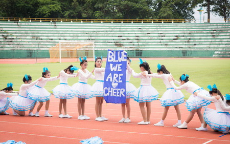 cooperate: PHUKET, THAILAND - JUL 13 : Schoolchild cheerleaders in the stadium on July 13, 2016.  Yearly athletics competition of Anuban Phuket School in phuket, Thailand