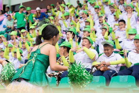 PHUKET, THAILAND - JUL 13 : Cheering team schoolchild in the stadium on July 13, 2016.  Yearly athletics competition of Anuban Phuket School in phuket, Thailand
