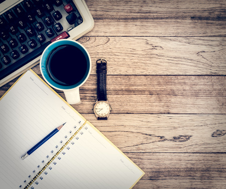 Office Desk Background. Coffee, Notepad, Pencil, Wristwatch And Typewriter  On Vintage Wooden