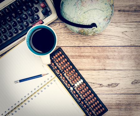 Office Desk Background. Coffee, Notepad, Pencil, Abacus, Globe And  Typewriter On
