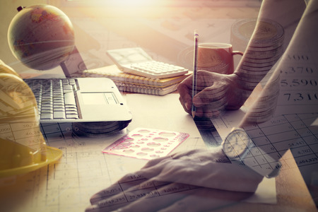 shinning: Hands of architect drawing construction plan. Double exposure photo finance accounting and investment under shinning light Stock Photo