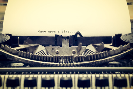 phrase novel: Words Once upon a Time written with old typewriter on white paper in vintage style