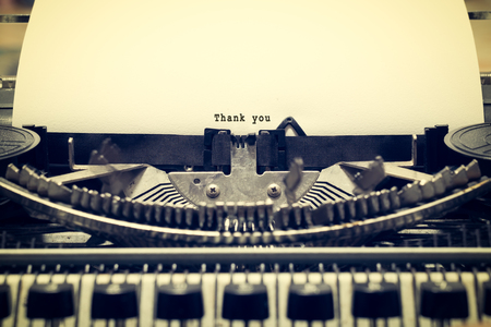 phrase novel: Words Thank you written with old typewriter on white paper in vintage style