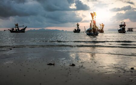 koh samui: Fishing boats on the sea with cloudy sky during sunset in koh samui, Thailand