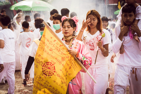 taoism: PHUKET- OCT 07 : Taoism participants in a street procession of the Phuket Vegetarian Festival on Oct 07, 2016 in Phuket, Thailand. During festival devotees abstain from eating meat to appease the God. Editorial