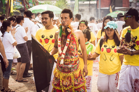 appease: PHUKET- OCT 07 : Taoism participants in a street procession of the Phuket Vegetarian Festival on Oct 07, 2016 in Phuket, Thailand. During festival devotees abstain from eating meat to appease the God. Editorial