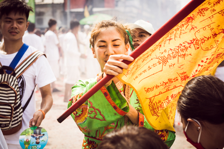 PHUKET- OCT 07 : Taoism participants in a street procession of the Phuket Vegetarian Festival on Oct 07, 2016 in Phuket, Thailand. During festival devotees abstain from eating meat to appease the God. Editorial