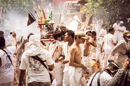 lunar month: PHUKET- OCT 07 : Taoism participants in a street procession of the Phuket Vegetarian Festival on Oct 07, 2016 in Phuket, Thailand. During festival devotees abstain from eating meat to appease the God. Editorial