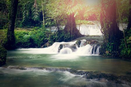 manora: Sa Nang Manora cascade waterfall in tropical rain forest under sunlight, Phang Nga, Thailand