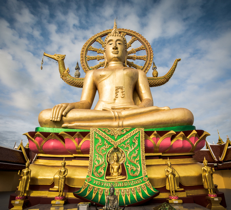 Big Buddha statue at Wat Phra Yai temple with blue sky in the morning on Koh Samui, Suratthani, Thailand Stock Photo