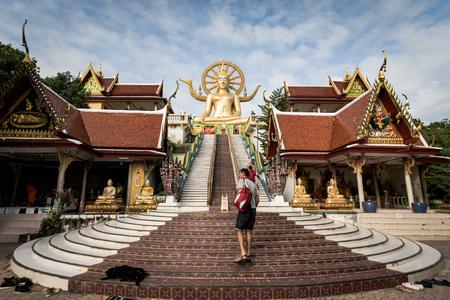 KOH SAMUI, THAILAND - DEC 24 : Big Buddha at Wat Phra Yai temple is 12-metre seated Buddha statue was built in 1972 in Koh Samui on December 24, 2016. Suratthani, Thailand.