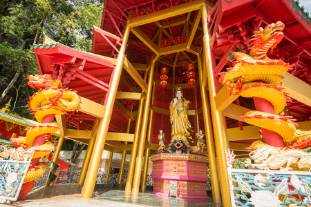 Chinese style pagoda with a giant statue of Guan Yin or goddess of compassion and mercy at Tiger Cave Temple (Wat Tham Seua). Krabi, Thailand Editorial