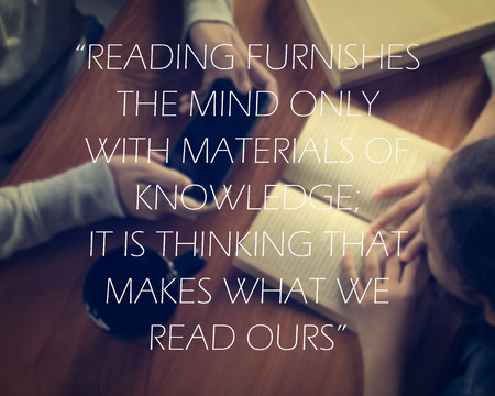 ours: Inspirational quote on girl reading a book and another girl holding smart phone background. Reading furnishes the mind only with materials of knowledge; it is thinking that makes what we read ours.