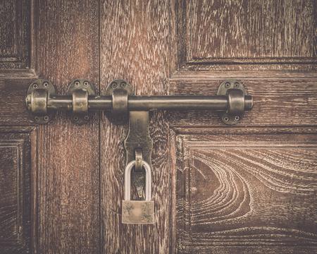 Old wooden door is locked, Vintage style background. Stock Photo