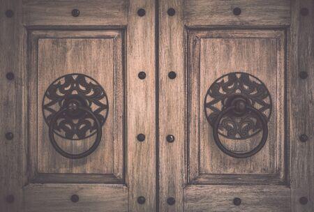 Retro wooden door with metal handle background