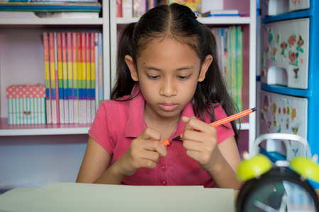 Little girl drawing on table at home, Education concept.