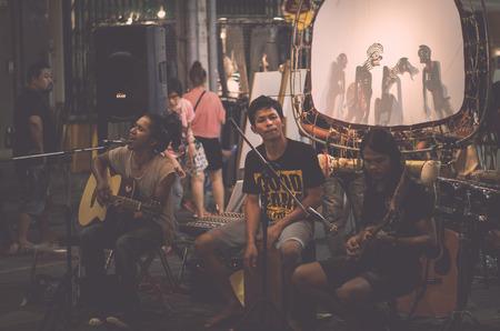 PHUKET, THAILAND-FEBRUARY 23, 2018 : Folk music band is performing on the street at night in phuket, Thailand.