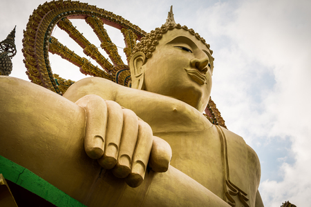 Close up big buddha statue with cloudy blue sky in koh samui, Thailand.