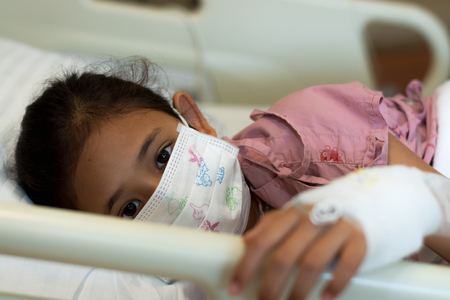 Little girl patients wearing protective mask in the hospital. Healthcare and medical concept. Stock Photo - 109737262
