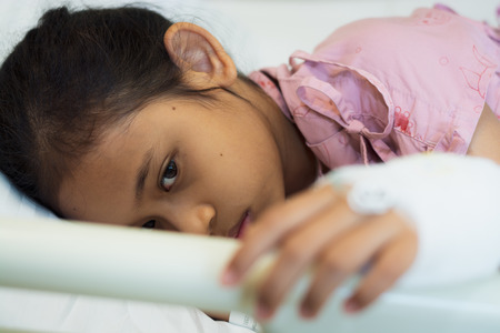 Little girl patients laying on the bed in the hospital. Healthcare and medical concept.