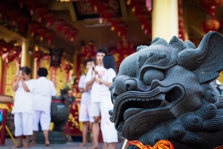 Chinese lion statue in Jiu Tean Geng Shrine where is respect greatly by Phuket people, Phuket, Thailand. Stock Photo