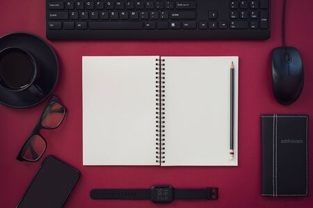 Blank white notepad with black office and personal accessories isolated on red background, Business motivation and inspiration concepts. Imagens