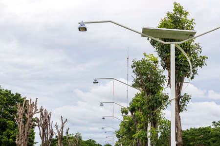 solar street lamp at public park on cloudy and blue sky background