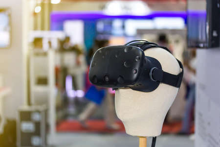 Close up head of mannequin wear Vr visual on blur background with copy space