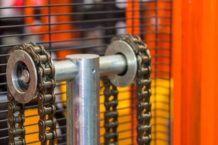 close up chain of pallet hand lift or forklift truck for industrial work
