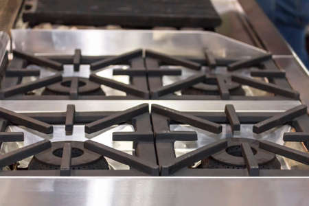 close up modern gas stove made from steel or cast iron or copper Фото со стока