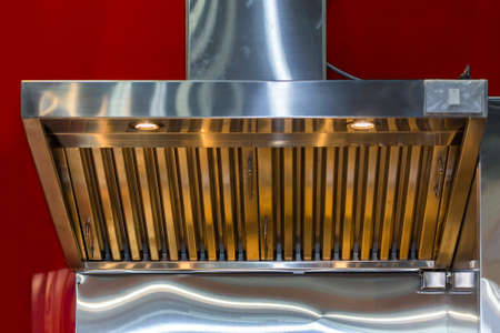 close up modern of kitchen hood made from stainless for exhaust dust and smoke Фото со стока