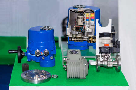 Many type of electric automatic valve and cross section show inside for pressure control for industrial work on table