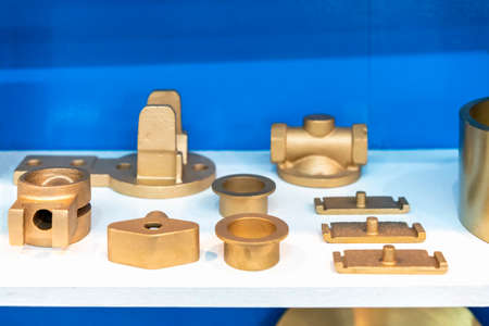 many type and various of industrial casting parts gold color or brass on table