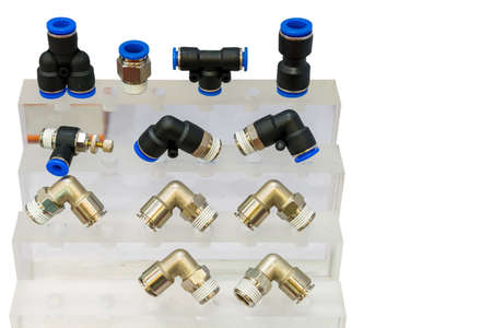 many kind of metal and plastic quick coupling or fittings equipment connector for air or liquid on shelf with isolated on white background
