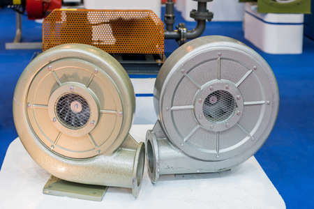 Close up modern and high technology of industrial centrifugal vortex or pressure blower with motor on table