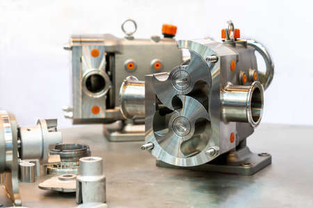 Close up cross section show detail inside of High technology and quality rotary or lobe gear vacuum pump for industrial on table with accessory