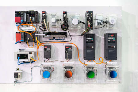 advance technology automatic Programmable Logic Controller PLC and many of high precision and accuracy equipment circuit connection diagram for system control in industrial work on wall