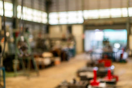 Blur photo for background inside a building or group of buildings where goods are manufactured or assembled chiefly by machine