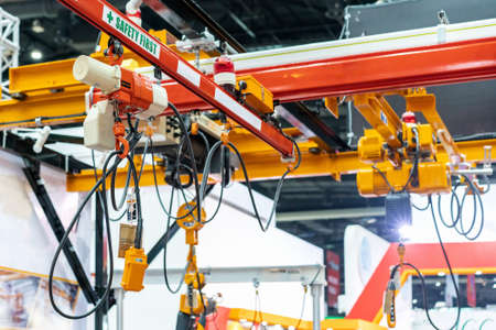 Overhead electric chain hoist with hook and remote switch control