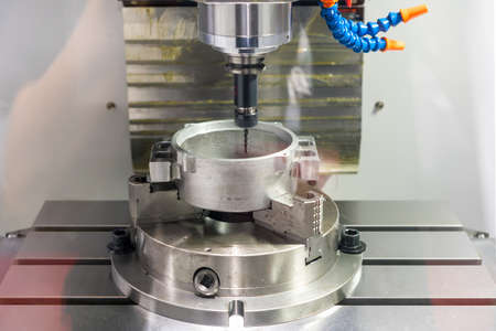 Close up screw tapping tool and workpiece at high accuracy cnc milling machine at factory