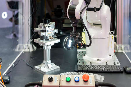 high technology and precision robot grip with automated vision inspection camera for check or measuring product or work piece on table in manufacturing process at factory or work shop