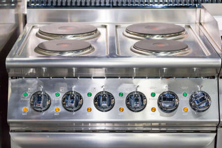 close up modern of induction electric stove and many knob dial on control panel for industrial food