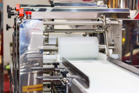 close up cylindrical die and belt conveyor of automatic food making machine for chinese or asian food steamed stuffed buns (production line for high technology industrial food manufacturing)