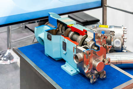 Close up cross section of High technology and quality rotary or lobe gear vacuum pump with gear box for industrial on table