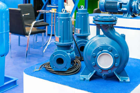 High pressure Centrifugal blue pump include motor on table Stock fotó
