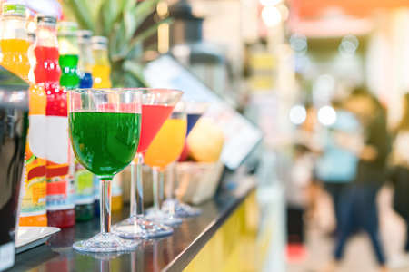 colorful nectar and many in cocktails glass on table with copy space Zdjęcie Seryjne