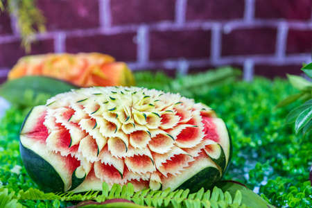 Colorful and beautiful watermelon carved or sculpted on green leaf