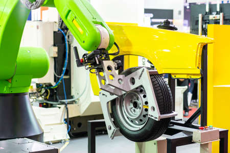 high technology and precision robot grip with automatic clamp or chuck for catch wheel and tire remove or assembly with car structure in manufacturing process